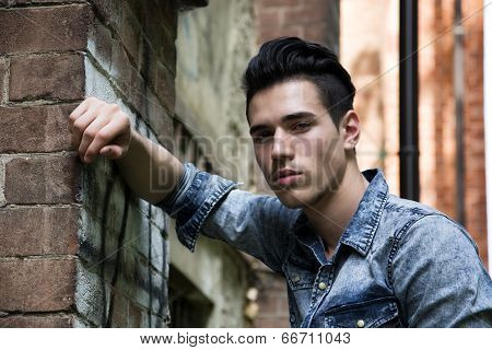Handsome Black Haired Young Man In Denim Shirt