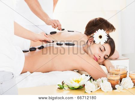 Couple Receiving Lastone Therapy