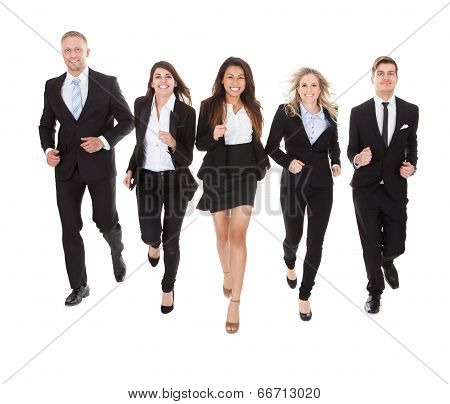 Portrait Of Welldressed Businesspeople Running