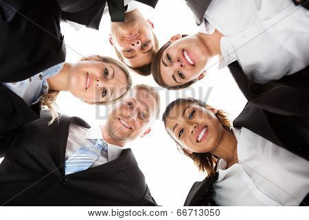 Portrait Of Business People Forming Huddle