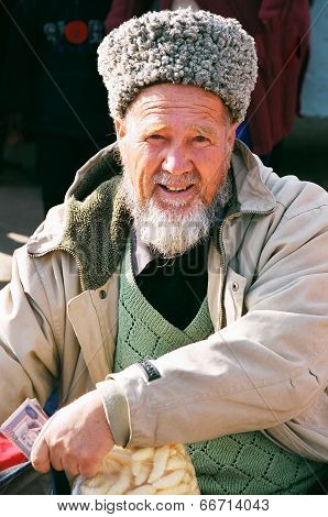 Ashgabat, Turkmenistan - February 26.  Portrait Of Turkmen Man In Telpek With Bushy Beard. Oriental