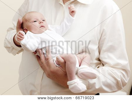 newborn baby girl lying in arms