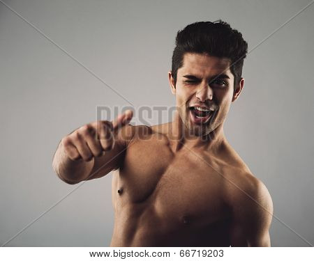 Happy Masculine Man Showing Thumbs Up Sign