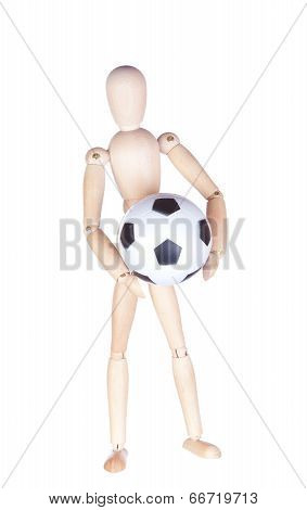 Wooden figure of the person with a soccerball