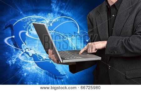 Blue Vivid Image Of Globe And Man On Laptop