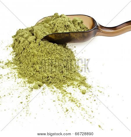 powdered green tea with spoon , isolated on white background