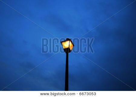 Lampost with winter sky in background