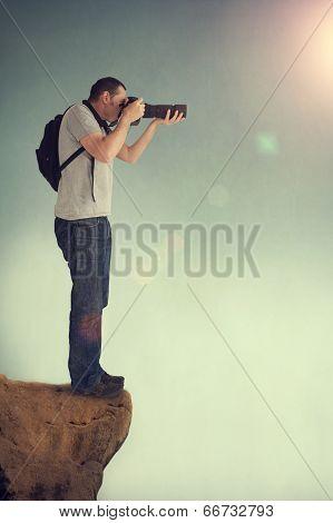 Photographer On Cliff Ledge