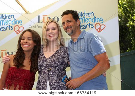LOS ANGELES - JUN 14:  Grant Heslov, daughters at the Children Mending Hearts 6th Annual Fundraiser at Private Estate on June 14, 2014 in Beverly Hills, CA