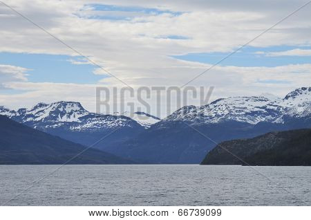 Patagonian Landscape With Mountains And Lake