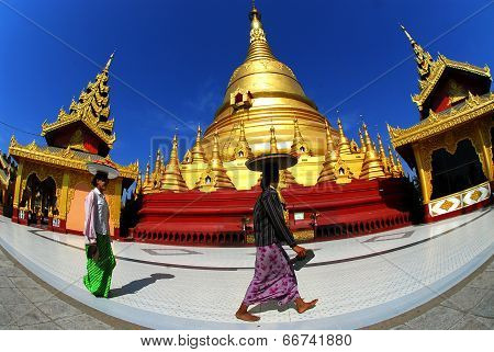 Women carrying Fruits on her head at Shwemawdaw Paya Pagoda.