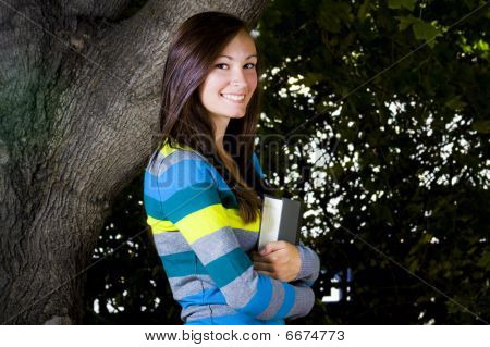 Beautiful Teenager Holding A Book