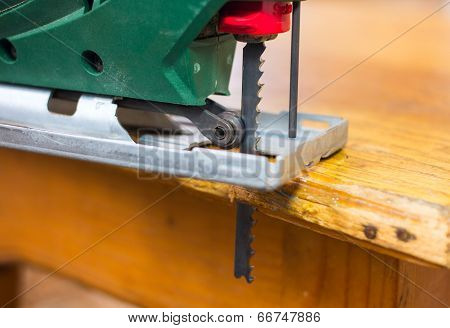 Close Up  Electric Jigsaw Cutting A Piece Of Wood
