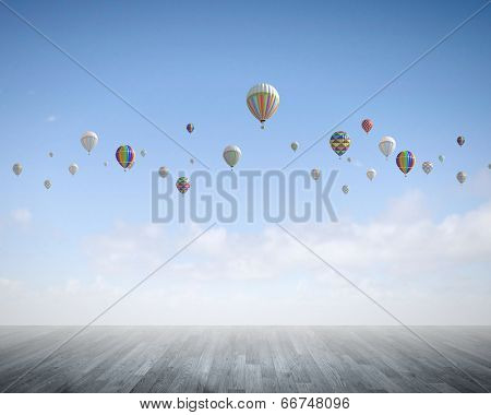 Conceptual image with colorful balloons flying high in sky