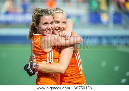 THE HAGUE, NETHERLANDS - JUNE 14 2014: Ellen Hoog hugs Jacky Schoenaker, celebrating their victory over Australia (2-0), and becoming world champions
