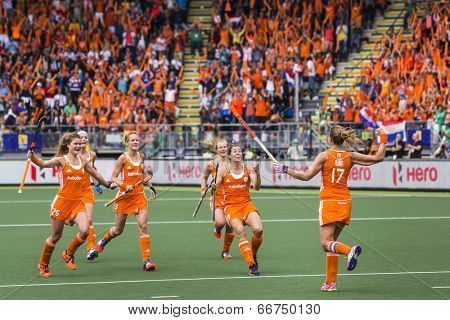 THE HAGUE, NETHERLANDS-JUNE 14,2014: Maartje Paumen (NED) runs back to cheer with her team after scoring 1-0 from a penalty push against Australia during the finals of the World Championships Hockey