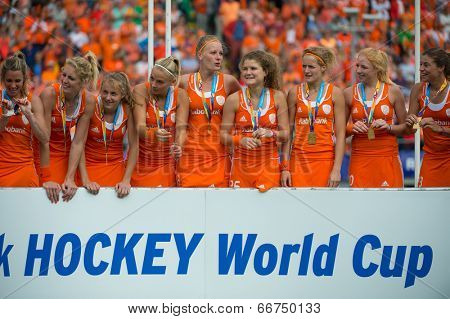 THE HAGUE, NETHERLANDS - JUNE 14: The Netherlands women field hockey team celebrates on the podium during the prize winning ceremony after beating Australia and becoming World Champions for 2014