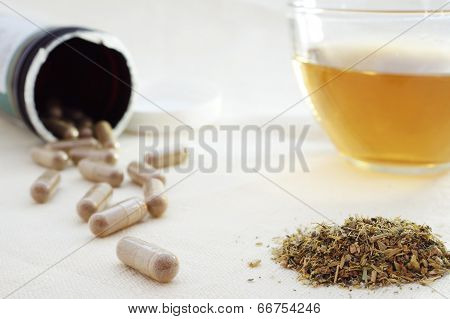 mixture of dried herbs  with herbal tea and herbal pills