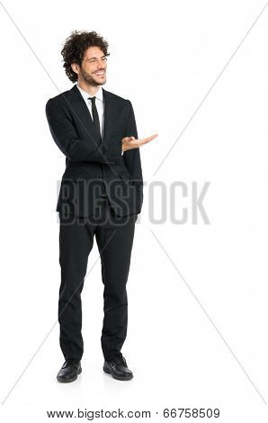 Portrait Of Young Man In Tuxedo Giving Presentation Isolated On White Background