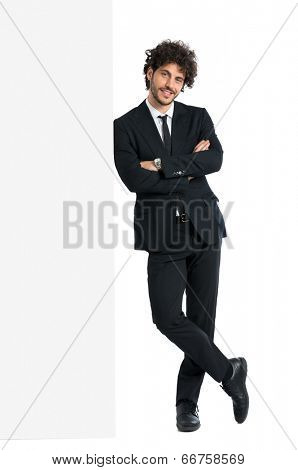 Young Elegant Man Leaning On Billboard Isolated On White Background
