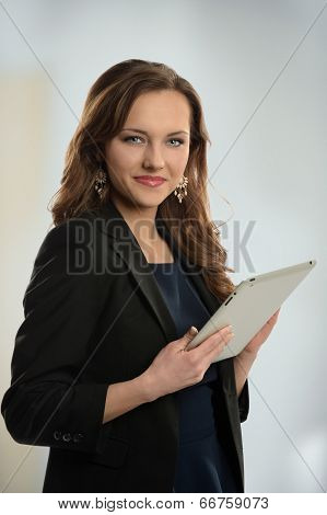 Businesswoman using electronic tablet inside office building