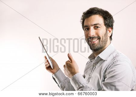 Positive Business Man Using A Tablet Computer