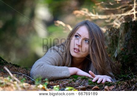young woman portrait outdoor in autumn
