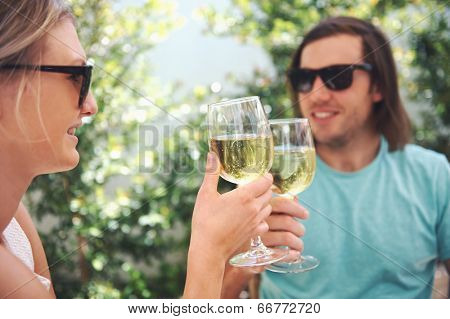 Couple drinking white wine at lunch while on summer vacation