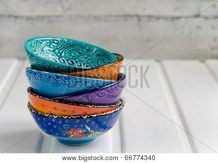 Colored ceramic dish on wooden table