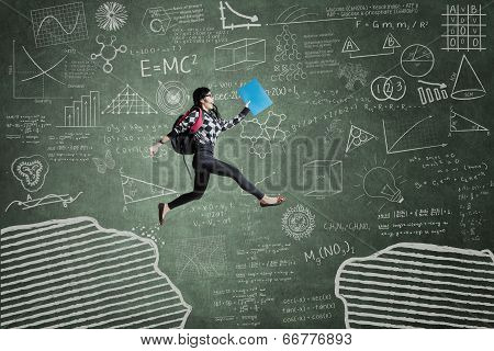 Excited Student Jumping On Gap