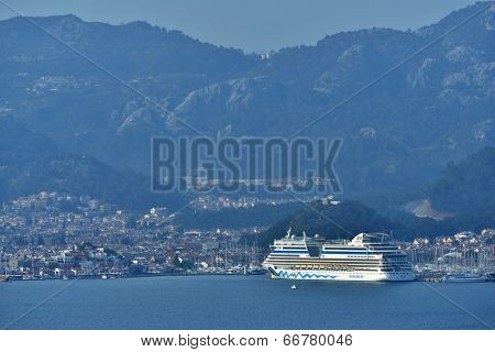 MARMARIS, TURKEY - APRIL 3, 2014: Cruise ship AIDAdiva in the port of Marmaris. AIDA ships cater to the German-speaking market, and has 94% average guests satisfaction rate