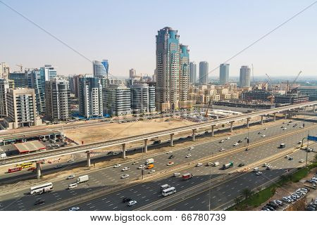 DUBAI, UAE - MARCH 30: Cars on Sheikh Zayed Road in Dubai on March 30, 2014, UAE. This is the longest highway in the United Arab Emirates and links the two largest cities - Abu Dhabi and Dubai.