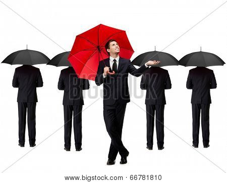 Palming up man with opened red umbrella checks the rain, isolated on white. People with umbrellas stand behind him
