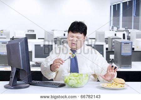 Overweight Businessman Avoid Junk Food