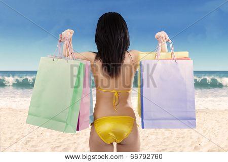 Woman Holding Shopping Bag At Beach 1