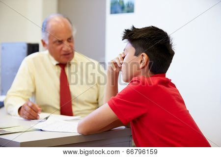 Male Student Talking To High School Counselor