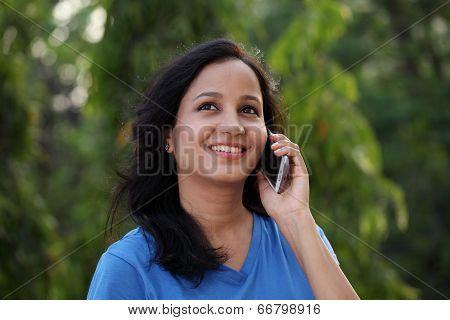 Happy Young Woman Talking On Mobile Phone