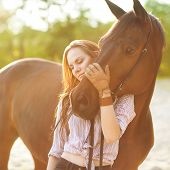 picture of sorrel  - Beautiful woman and sorrel horse near the river - JPG