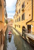 picture of gondolier  - Gondola with gondolier in Venice channel - JPG