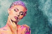 picture of time-piece  - Beautiful young woman with conceptual colourful body art  - JPG