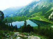 stock photo of bavaria  - A view of mountains and a lake in high mountain resort in Bavaria - JPG