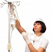 picture of intravenous  - Beautiful young nurse preparing to hold intravenous drip medication - JPG