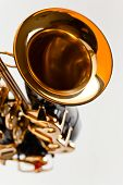 stock photo of saxophones  - closeup of saxophone focus on a foreground - JPG