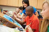 image of 13 year old  - Male Pupil In High School Art Class With Teacher - JPG