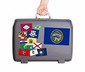 picture of nebraska  - Used plastic suitcase with stains and scratches stickers of US States Nebraska - JPG