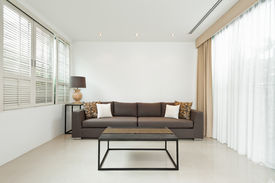 picture of louvers  - Bright Living room with grey sofa and minimalistic decoration - JPG