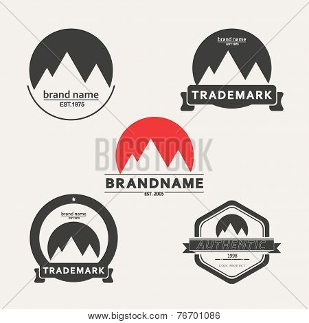 Vector set of five emblems associated with mountains