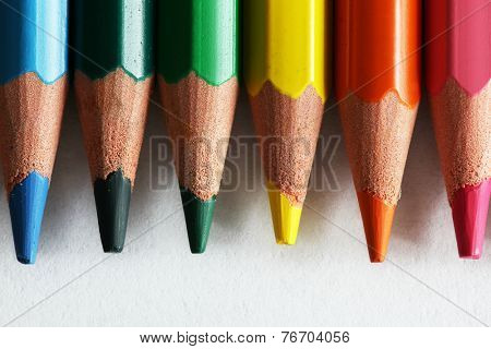 Close-up of colorful pencils arranged as a color pallete and isolated on white. Concepts of creativity, art, school etc.