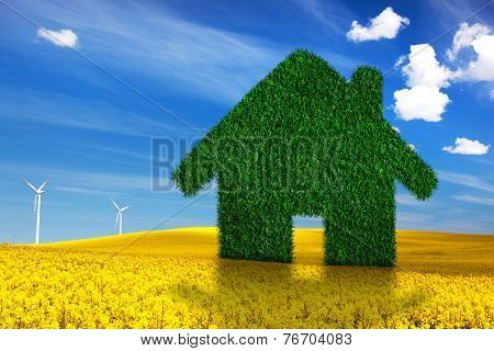 Green, ecological house, real estate concept. Spring land, blue sky, wind turbines. Clean energy, environment