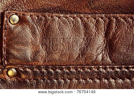 Genuine brown leather with seam. Background, pattern, texture.